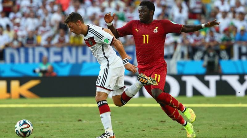 Sulley Muntari fighting German's Mesut Ozil for the ball during the 2014 FIFA World Cup in Brazil
