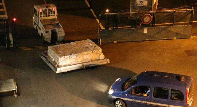 The debris was packed into a crate for the flight to Paris