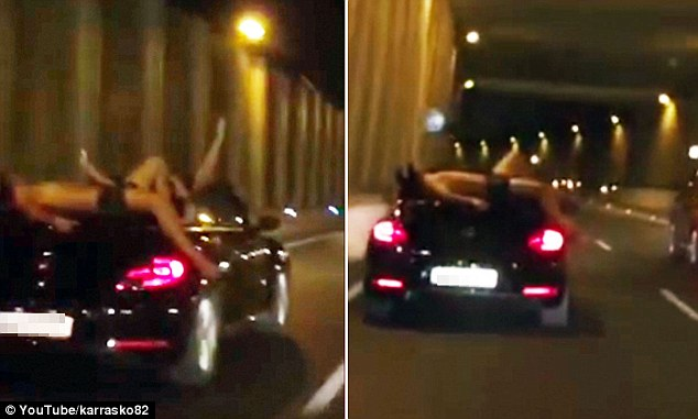 It was unknown if the tourist, whose leg was hanging over the edge of the car, was strapped down