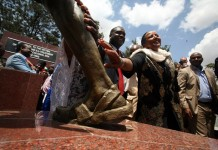 Kenyan Foreign Affairs Cabinet Secretary Amina Mohamed (Front R) and Kenyan Cabinet Secretary for Sports,Arts and Culture Hassan Wario touch the Mau Mau sculpture erected at Freedom Corner in Uhuru Park, Nairobi, capital of Kenya, Sept. 12, 2015. The Monument which was erected at the park on Saturday is part of reconciliation efforts between the British government and Mau Mau veterans, for torture and ill treatment during the colonial era between 1952 to 1960. (Xinhua/John Okoyo)