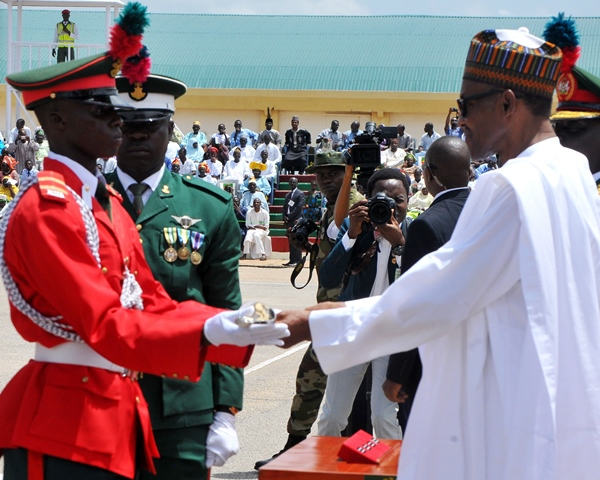 Nigeria's President Muhammadu Buhari (R) presents a sword to a graduating military best cadet F.A Tajudeen during the graduation parade of the Nigeria Defence Academy (NDA) cadets in Kaduna, northwestern Nigeria, Sept. 12, 2015. The graduation parade of the 62 regular course and short service course 43 of the NDA cadets was held here on Saturday. (Xinhua/Dare Sholarin)