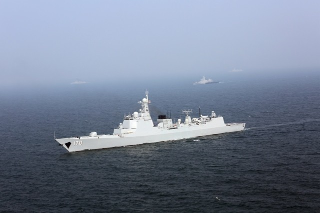 """Chinese and Malaysian naval vessels take part in a joint escort exercise during their first joint military drill, coded """"Peace and Friendship 2015"""", in the Malacca Strait, Sept. 19, 2015. (Xinhua/Liu Wei) (zw)"""
