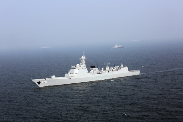 Chinese and Malaysian naval vessels take part in a joint escort exercise during their first joint military drill, coded