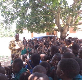 Mr. Ganyaglo interacting with some school pupils