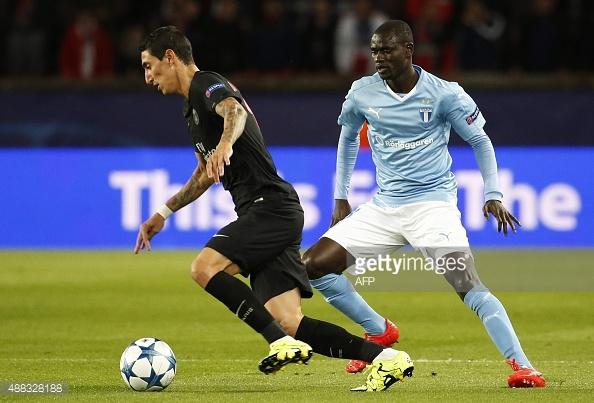 Enock Adu Kofi challenges Di Maria for the ball