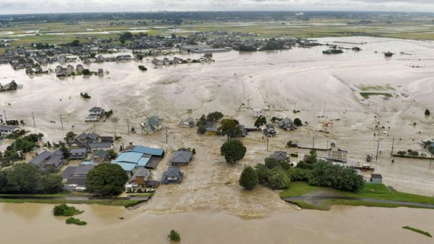 The Kinugawa River in Joso burst its bank on Thursday, flooding homes