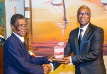 Dr Wilfred Kwabena Anim-Odame (right), Executive Secretary of the Lands Commission receiving the award