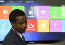 A teacher reacts during the testing of new school net program at Minilik high school after the launching ceremony in Addis Ababa, Ethiopia, Oct. 9, 2015. Ethiopia on Friday launched a school net system by china's leading telecom company Huawei in Ethiopia's capital. The system connects 64 high schools and one university collage to share resources and make educational exchange. (Xinhua/Michael Tewelde)
