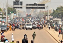 The photos taken on Oct. 9, 2015 show the crowd accompanying the coffins of martyrs to their final resting place at the Gounghin municipal cemetery during the funeral ceremony in Ouagadougou, capital of Burkina Faso, Oct. 9, 2015. 14 people have been killed and more than 200 wounded since the coup of the former Presidential Security Regiment (RSP) led by Gen. Gilbert Diendere on Sept. 16. (Xinhua/Remi Zoeringre)