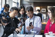 Henry Hui (2nd R), project manager of ZTE Canada Inc., introduces an AXON smartphone to visitors during the phone's official launch ceremony in Toronto, Canada, Oct. 27, 2015. As the fourth-largest smartphone supplier in North America, China's Zhongxing Telecommunication Equipment Corporation (ZTE) on Tuesday inaugurated AXON, its first smartphone product in Canadian market, in cooperation with local carrier Rogers Communications. The smartphone AXON will be available for purchase in Canada on Nov. 6. (Xinhua/Zou Zheng)