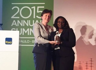 Ope Wemi Jones - Head of Inclusive Banking at Access Bank receiving the award on behalf of the Bank