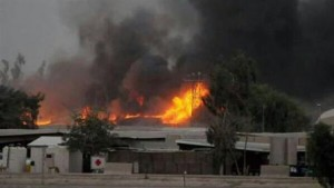 Fire and smoke rise after rocket attacks