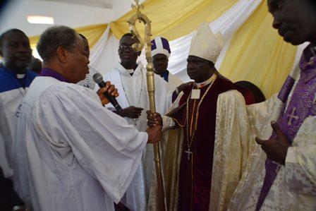 Most Elder Bishop Isaac Wutumi handing over the staff to His Eminence Prince Adegoke