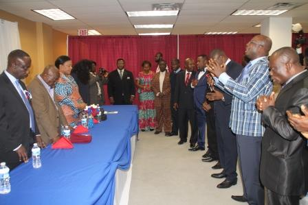 The Ministers With their hands stretched forth toward Nana Akufo Addo and praying for him