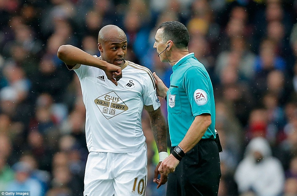 Ayew seems to suggest to referee Neil Swarbrick that an elbow was used in a challenge during the first-half