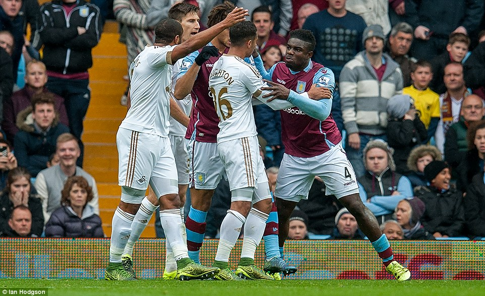 Swansea defender Kyle Naughton gets in the middle of Micah Richards (right) and Ashley Williams (left) as the duo argue