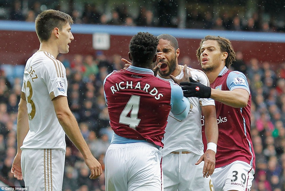 The opposing captains scream at each other during a feisty first-half at Villa Park on Saturday afternoon