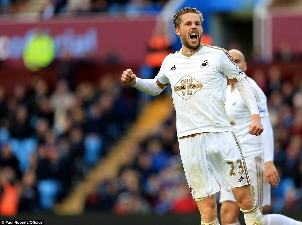 Sigurdsson celebrates after his free-kick brought Swansea back into the game at 1-1 in Birmingham on Saturday