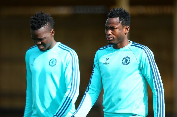 Baba Rahman, training with Burkina Faso international Bertrand Traore, has been tipped to follow in the footsteps of Carvalho at Chelsea