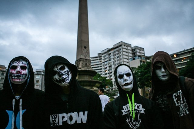 People attend a Zombie March, held during the Halloween celebration, at Plaza Altamira of Caracas, Venezuela, on Oct. 31, 2015. (Xinhua/Boris Vergara)