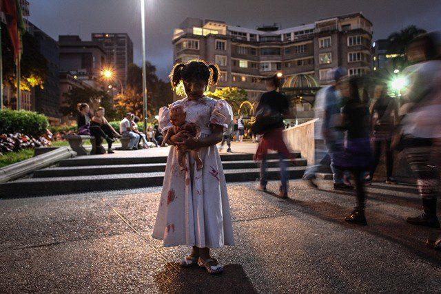 A girl attends a Zombie March, held during the Halloween celebration, at Plaza Altamira of Caracas, Venezuela, on Oct. 31, 2015. (Xinhua/Boris Vergara)