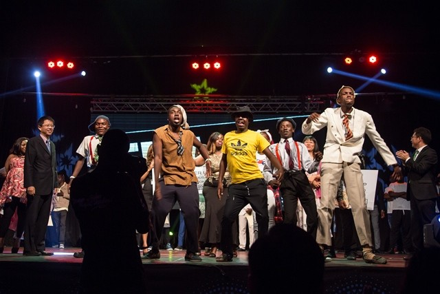 Members of a winning group  celebrate during the final of Zimbabwe's Dreamstar 2015 talent show, in Harare Oct. 31, 2015. The show, organized by local Chinese community, provides an opportunity to thousands of Zimbaweans pursuing their dreams on stage. (Xinhua/Xu Lingui)