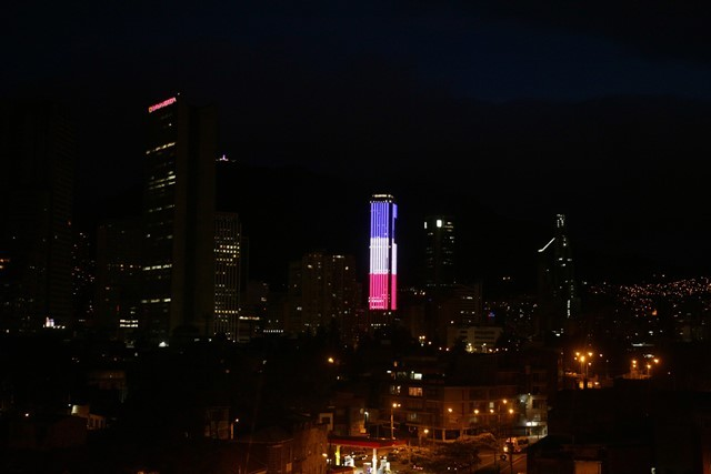 Image provided by Colombia's Presidency shows the Colpatria Tower illuminated with the colors of the French national flag to mourn for the victims of the terrorist attacks in Paris, in Bogota, Colombia, on Nov. 14, 2015. (Xinhua/Colombia's Presidency) (zjy)