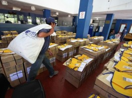 An employee of the Argentine Mail walks among ballot boxes that are ready to be delivered before the second round of the presidential elections, in Resistencia City, Chaco province, Argentina, on Nov. 21, 2015. A total of 32 million Argentinians are eligible to vote in the second round on next Sunday to elect the president that will succeed Cristina Fernandez in December. (Xinhua/German Pomar/TELAM) (da) (fnc)