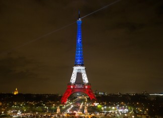 The Eiffel Tower is lit with the blue, white and red colours of the French flag in Paris, France, Nov. 16, 2015, to pay tribute to the victims of the terror attacks on Friday in the French capital. (Xinhua/Xu Jinquan)