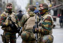 """Belgian soldiers patrol in central Brussels, capital of Belgium, on Nov. 22, 2015. The terror threat level in the Brussels region was increased to """"maximum"""" as authorities received information on the risk of an attack """"similar to Paris."""" The terror threat currently facing Belgium is """"broader than Salah Abdeslam alone"""", the country's interior minister Jan Jambon said in a TV interview late Saturday. (Xinhua/Zhou Lei)"""