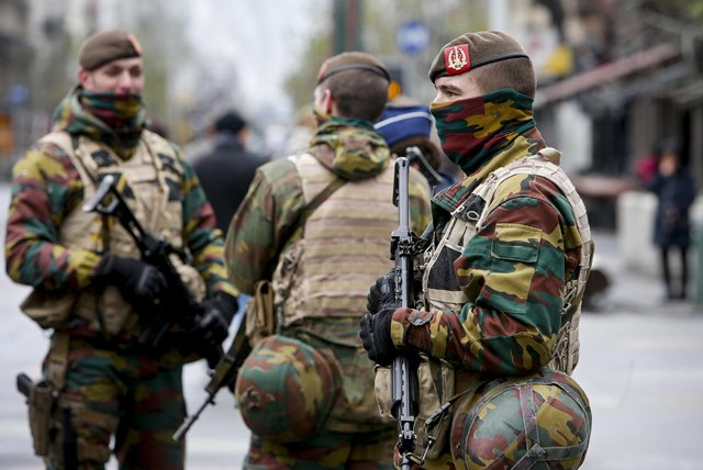 Belgian soldiers patrol in central Brussels, capital of Belgium, on Nov. 22, 2015. The terror threat level in the Brussels region was increased to