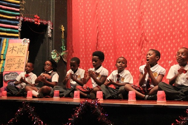Students from The Zambia Chinese International School perform a song during a drama performance in Lusaka, capital of Zambia, Nov. 21, 2015. The drama was based on a Chinese legend: A young woman named Hua Mulan who disguised herself as a man to join the army in order to stand for the duty of her old and ailing father. (Xinhua/Du lisha)