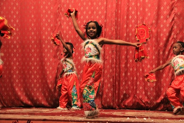 Students from The Zambia Chinese International School perform a drama named Mulan in Lusaka, capital of Zambia, Nov. 21, 2015. The drama was based on a Chinese legend: A young woman named Hua Mulan who disguised herself as a man to join the army in order to stand for the duty of her old and ailing father. (Xinhua/Du lisha)
