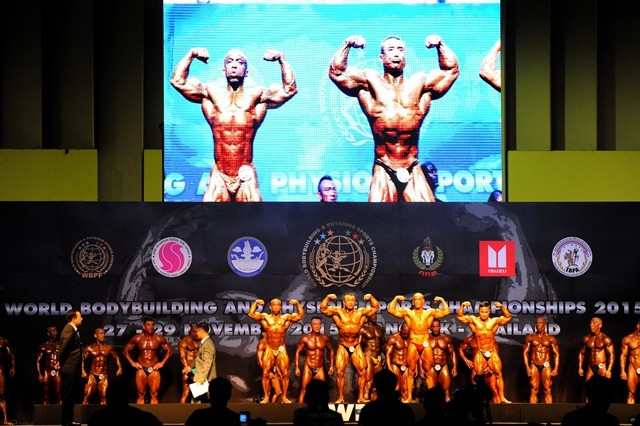 Competitors flex their muscles during World Bodybuilding and Physique Sports Championship 2015 in Bangkok, Thailand, Nov. 27, 2015. The three-day competition attracted more than 800 bodybuilding enthusiasts across the world. (Xinhua/Rachen Sageamsak)