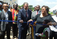 Ms Hannah Serwaa Tetteh (right) being assisted by Mr Francois Pujolas to cut the tape to open the exhibition at the Pre-Conference of Parties 21 (COP21) climate change festival in Accra.