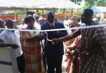 Nana Adu and the Headmistress cutting the tape to launch the anniversary