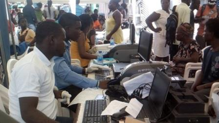 Officials from NHIS registering the June 3 Flood and Fire disaster victims