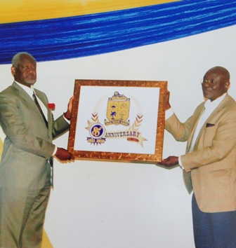 Anniversary launch Board Chairman Mr. Wilson Tei and Rt. Hon. Speaker of Parliament Edward Doe Adjaho display the anniversary logo.