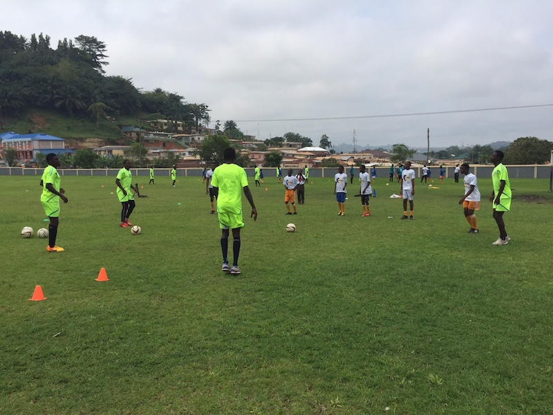 AshantiGold players and pupils of the AGA Schools in Obuasi during a clinic.
