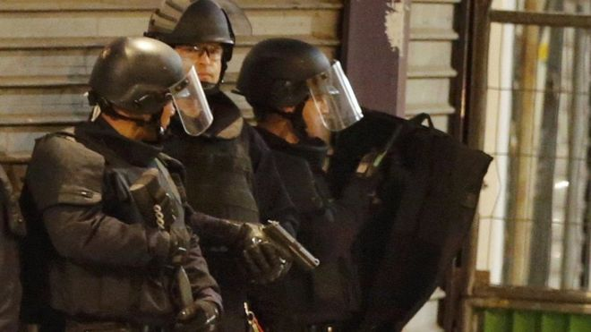 Armed police sealed off the area as shots rang out in Saint Denis