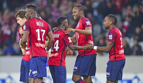 Yaw Yeboah, middle celebrating a goal with Lille team-mate, is at Lille on loan from Man City