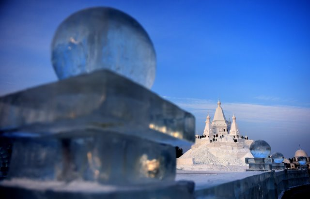 Snow sculptors work on a snow sculpture, which will be the highest in the world, in Taiyangdao, a small island in Harbin, northeast China's Heilongjiang Province, Dec. 24, 2015. The 51-meter-high sculpture will be completed by the start of 2016.(Xinhua/Wang Jianwei)
