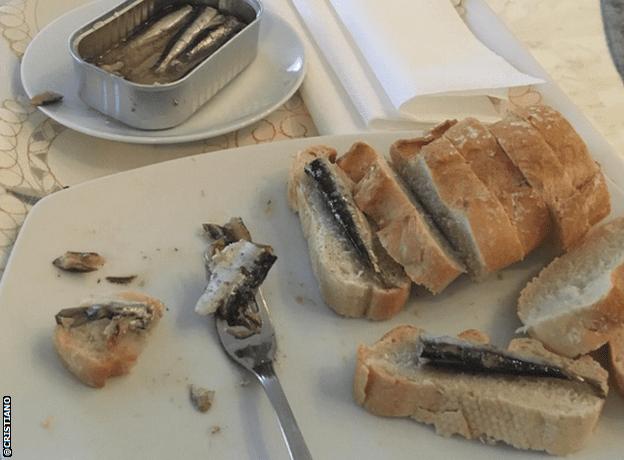 Cristiano Ronaldo eats a plate of sardines