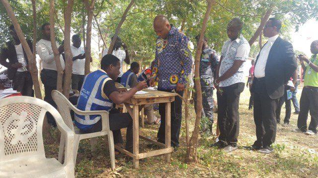 Hon Ablakwa checkig for his name in the register