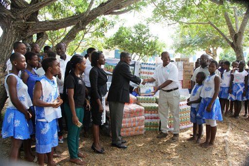 Mr Dan Amoah Managing Director Chase Petroleum donating the items to Mr Fred Asare Managing Director Village of Hope Orphanage at Senya Bereku.