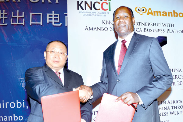 Kenya-National-Chamber-of-Commerce-and-Industry-vice-chairman-Laban-Onditi-with-Amanbo-chief-executive-Sunny-Liao
