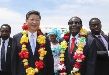 Chinese President Xi Jinping and President Robert Mugabe at the Harare International Airport