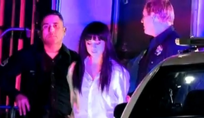 selena-gomez-flashes-bra-gets-arrested-in-her-music-video
