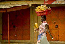 Plantain chips seller. Photo by Johnny Panessa. @johnnypanessa