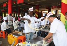 A local chef makes noodles during the temple fair held in Lusaka, Zambia, Jan. 24, 2016. The temple fair was held on Sunday to celebrate the upcoming Chinese Spring Festival in Lusaka. (Xinhua/Peng Lijun)